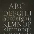 Photograph of sampler alphabet. Welsh slate.