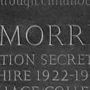 Photograph of plaque commemorating Henry Morris, Cambridge. Cumbrian green slate.