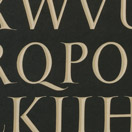 Photograph of a capital alphabet with the owner's name in italics. Welsh slate.