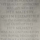 Photograph of opening plaque cut in situ at The School of Veterinary Medicine, Cambridge. Portland stone.